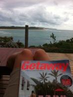 My feet up with latest Getaway watching Erik fish on the sandbank
