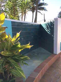 Outdoor shower in communal pool area